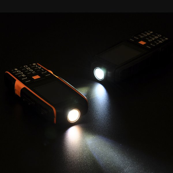 two mobile phones with light lamps