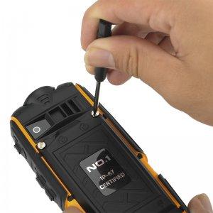 a hand repairing a mobile phone
