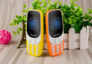 decoration and plants on the back of a yellow and orange cell-phone