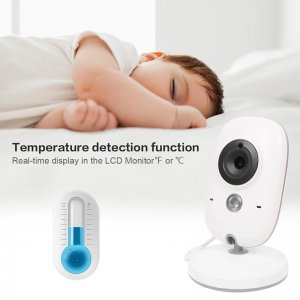 thermometer and white camera below sleeping baby