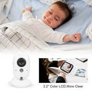 above white camera baby laughs contentedly in her sleep while being monitored on screen