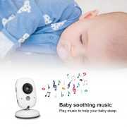 baby monitor and sleeping baby with a soother above music notes